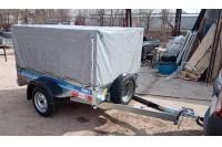 В дополнительной комплектации с каркасом и тентом Н1000 мм 2 клапана, заменой штатного шнурка крепления тента на резинку, подкатным колесом (не установлено) и запасным колесом на штатном месте
