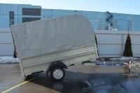 Прицеп в исполнении бортовой платформы с надставными бортами, тентом 1500 мм Аэро и дополнительным оборудованием